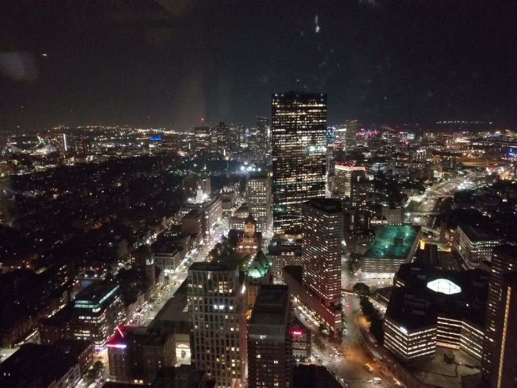 City of Boston at Night - Taken at the top of the Prudential Building in August 2018 on a clear evening. The glass and lights give it an eery feel.